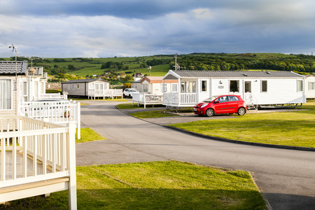 Prestatyn, North Wales, United Kingdom. September 10 2015: Late evening sunlight on the Welsh hills above a Typical British static caravan holiday park Wales U.K.