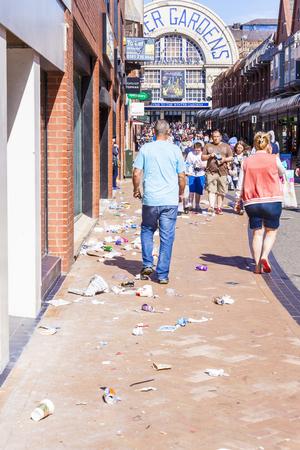 u k: Blackpool, England, U. K August 7 2016 : Litter Strewn  all over Church street near Blackpools famous Winter Gardens after strong winds Blackpool, England.