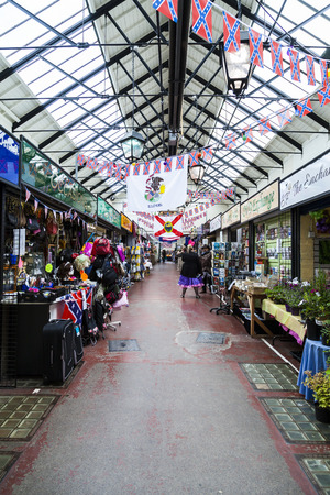 u.s. flag: Leek, Staffordshire Moorlands, England, U.K - June 18 2014 Market traders in fancy dress costumes at Leek indoor. Market. Leek  England