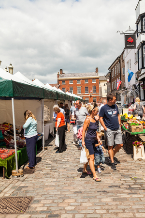 typically british: Leek, Staffordshire Moorlands, England, U.K - June 21 2014 : Shoppers at Leek�s open air market Leek  is an ancient borough and was granted its royal charter in 1214.