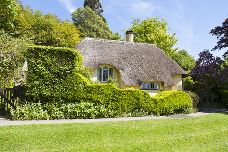 Minehead, Somerset, England - May 23, 2015 : Typical thatched roof cottage in rual England.