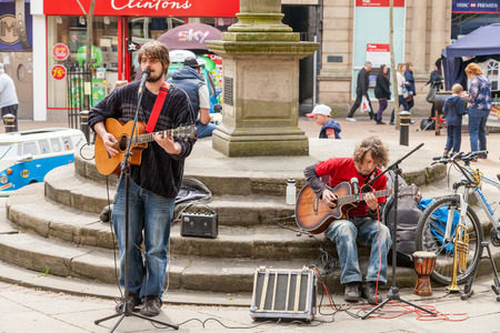 busker: Newcastle under lyme United Kingdom - May 5, 2014 : Street musicians performing at the Lymelight Festival. Newcastle Under Lyme, Staffordshire, England. Editorial
