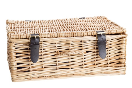buckled: Wicker picnic basket with leather brass buckled straps. Isolated on white. Stock Photo