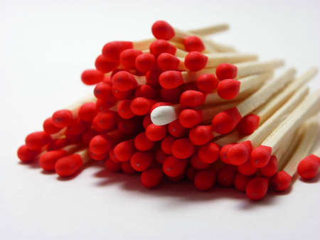 out of order: Macro photo of red and white matches on white background Stock Photo