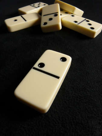 Macro photo of dominoes on black background photo