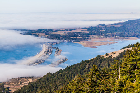 View of the Pacific Ocean and the Bolinas Lagoon. Sunny day and fog covering Stinson Beach photo