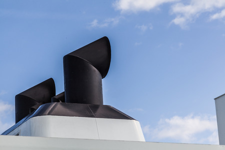 backgraound: abstract of the top of a ferry with blue sky on background