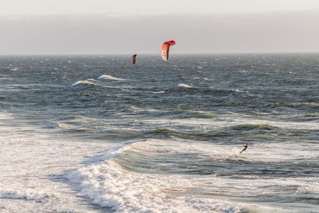 wind surfing: view of wind surfing at the Ocean Beach in San Francisco, CA during a cloudy sky,