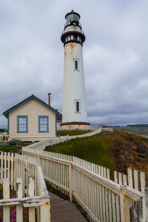 historic place: Pigeon Point lighthouse south of San Francisco,  under a cloudy day. historic place