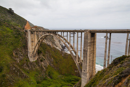 bixby: California Coastline near Big Sur, south of San Francisco, beautiful seascape with cloudy sky and colorful landscape, and the Bixby bridge Stock Photo