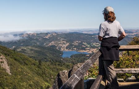 marin: Female looking at the Marin Lakes from top of Mt. Tamalpais in Marin County Stock Photo