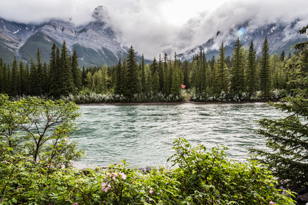 banff: River and mountain with clouds in Banff