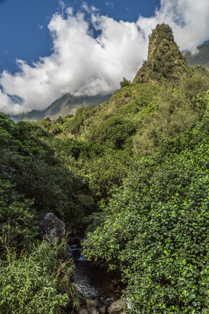 straight up: Iao Needle State Park in Central Maui. The Iao Needle is a solid green, needle-like mountain shooting straight up to the sky.