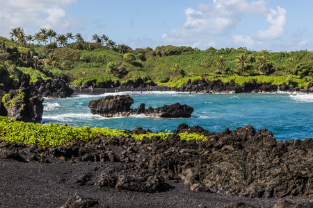 Great views of the Pacific Ocean and the East Maui coast line. Contrasting volcanic rocks and the ocean. Oneuli Black Sand Beach