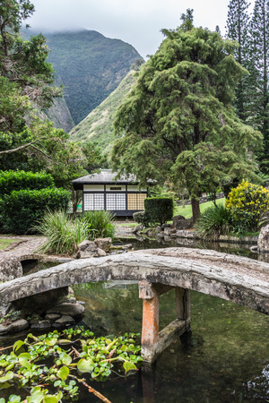 Kepaniwai Heritage Gardens. include traditional Hawaiian dwellings of ancient times as well as the traditional homes Stock Photo