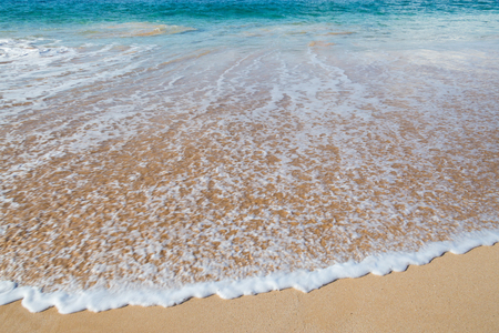 Wailea Beach, Maui, tawny-colored sand is lined by palm trees and a paved walkway connecting the shoreline to the areas hotels, shops and restaurants. Stock Photo