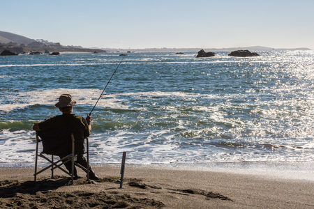 Seating by the ocean and fising. Beautiful landscape of the California Coastline, Sonoma County, Bodega Bay area on a sunny day Stock Photo