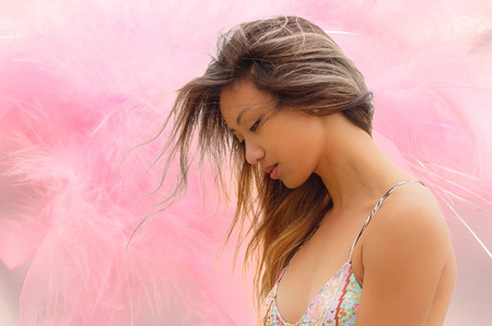 portraiture of a beautiful model, with feather like background