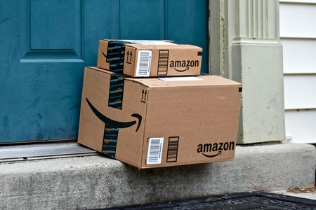 MARYLAND, USA - JANUARY 18, 2016: Image of Amazon packages delivered to a home. Amazon is the largest internet based retailer in the United States.