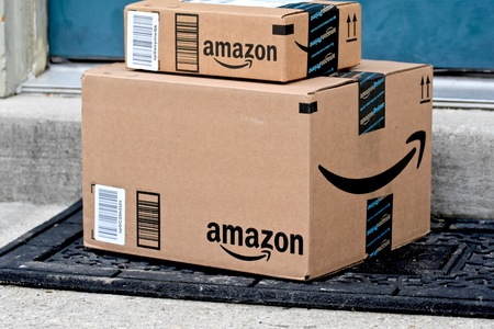 shipped: MARYLAND, USA - JANUARY 18, 2016: Image of Amazon packages delivered to a home. Amazon is the largest internet based retailer in the United States.