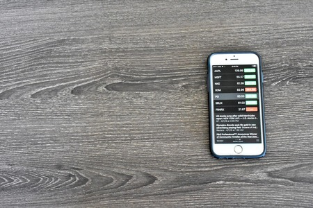 Maryland, USA - APRIL 3, 2016: An Apple iPhone 6s displaying stock market information on the stocks application. The iPhone is a product of Apple Inc.