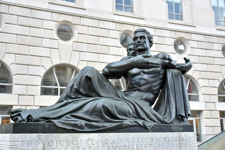 ronald reagan: WASHINGTON DC, USA - APRIL 2, 2016: A statue of a man and woman outside the Ronald Reagan Building and International Trade Center in Washington DC. The building is named after a former president. Editorial