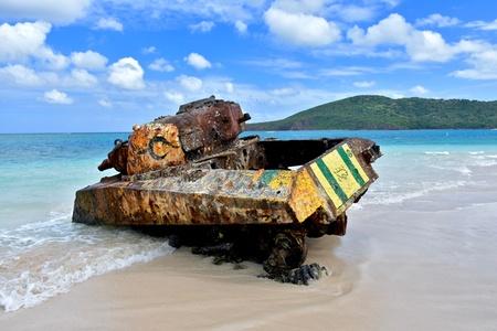 Old military tank on flamenco beach