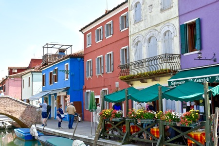 burano: BURANO, ITALY - APRIL 22, 2016: The colorful buildings of Burano, Italy. Burano is an island of Venice which is known for its colorful buildings.