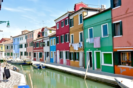 BURANO, ITALY - APRIL 22, 2016: The colorful buildings of Burano, Italy. Burano is an island of Venice which is known for its colorful buildings.