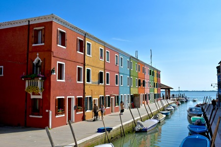 venician: BURANO, ITALY - APRIL 22, 2016: The colorful buildings of Burano, Italy. Burano is an island of Venice which is known for its colorful buildings.