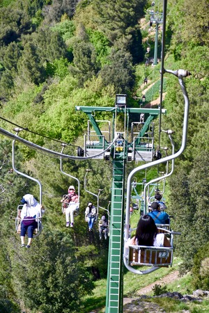 CAPRI, ITALY - APRIL 16, 2016: Tourists riding up the mountain lift to get to the top of Anacapri. Capri is a popular tourist destination and an island of Italy.