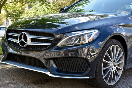MARYLAND, USA - MAY 7, 2016: A black Mercedes-Benz C400. Mercedes-Benz is a luxury car dealer and manufacturer. Editorial
