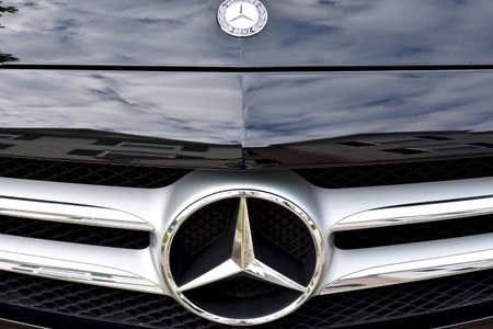 front end: MARYLAND, USA - 2016: The front end of a Mercedes-Benz displaying the Mercedes symbol Editorial