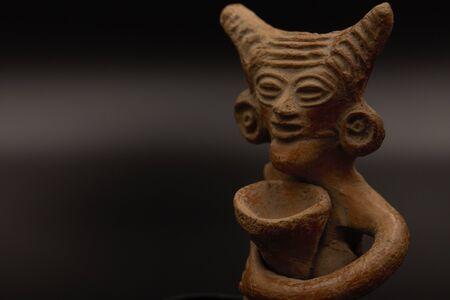 Indus Valley terra cotta figure carrying a vessel