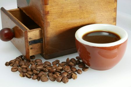 echange: Cup of black coffee and coffee beans Stock Photo