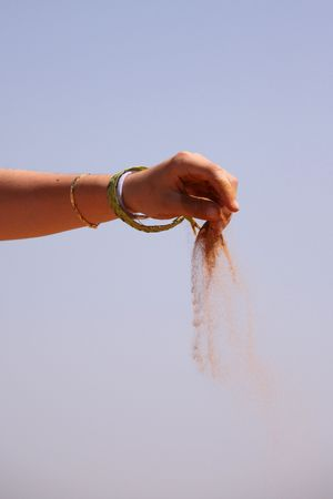 Hand and sand in the Moroccan desert