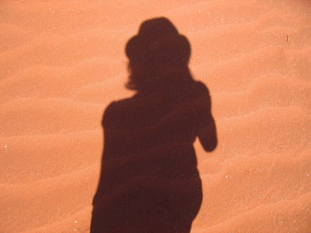 Shadow of a tourist in the desert photo
