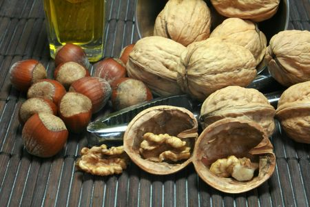 Tasting of walnuts and hazelnuts in autumn Stock Photo