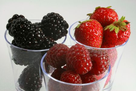 Tasting of strawberries raspberries and blackberries Stock Photo - 7577868