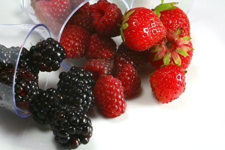 Tasting of strawberries raspberries and blackberries