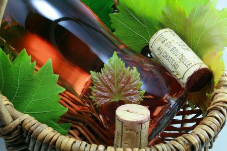 Basket of wine with bottle and corks Stock Photo