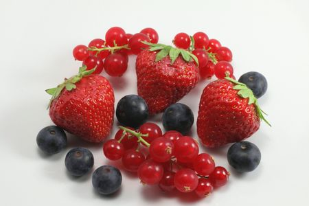 Strawberries, blueberries and currants photo