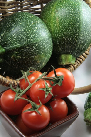 Basket of tomatoes and zucchinis photo