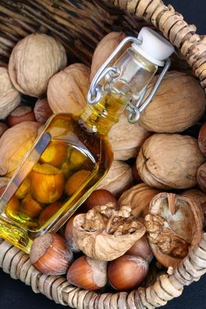 Basket of walnut in a basket with a bottle of oil