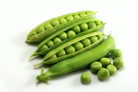 Fresh peas on a white background