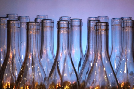 Wine bottles on a blue background photo
