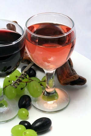 Tasting of wine with a bunch of grapes in detail photo