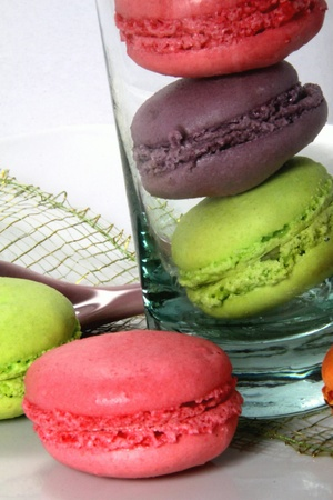Tasting of multicolored macaroons