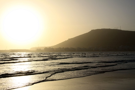 Sunset on the beach of Agadir Stock Photo
