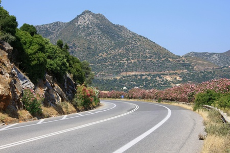 Sinuous road of mountain in Crete of the North Stock Photo
